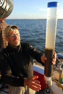 Mark Edlund recovers a short gravity core from Buffalo Bay, Lake of the Woods